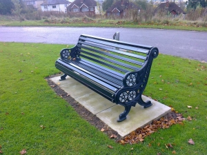 Black powdered coated bench with floral embellishment